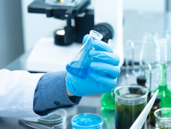 hand holding blue liquid in test tube